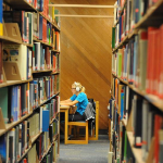 Bookshelves and student studying