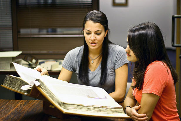 two women looking at a manuscript in Special Collections