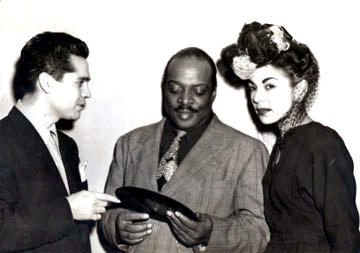 Tosti with Basie, presenting a copy of Pachuco Boogie - 1948