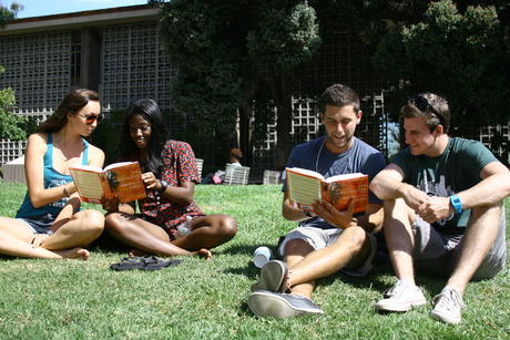 Students reading outside Library