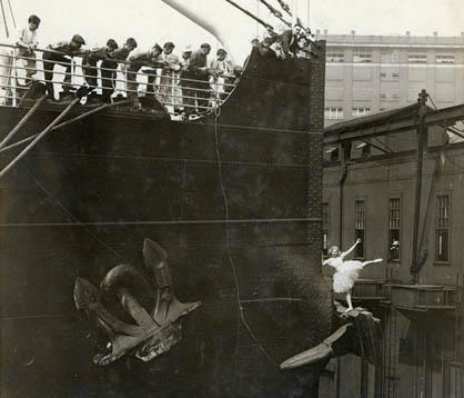 Detail of Dorothy Rae dancing on a ship's anchor.