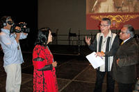 Photograph of Dan Guerrero directing ¡Adelita! with Luis Valdez & Dolores Huerta