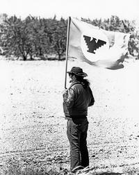 José Montoya holding the UFW flag during La Marcha de la Reconquista, 1971