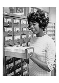 Photograph of Black Studies Librarian Rubye Ballard at the card catalog, 1971