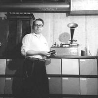 Allen G. Debus in his basement with his phonograph and record collection.