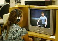 student watching a dvd
