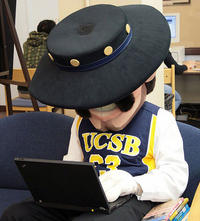 USCB mascot, Ole, using a laptop