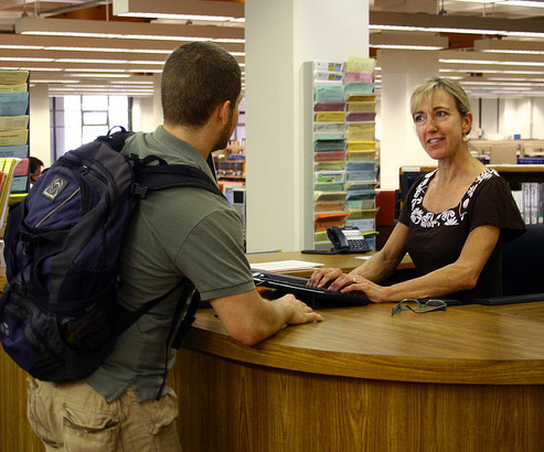 Library user getting help from reference librarian