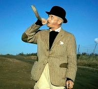 William Faulkner with hunting horn, at Farmington Hunt Club, 1960.
