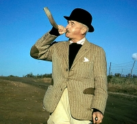 William Faulkner with hunting horn, at Farmington Hunt Club, 1960.