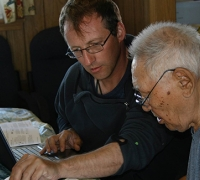 Aaron Fox working through Boulton recordings with the late Iñupiaq elder and music expert Warren Matumeak.